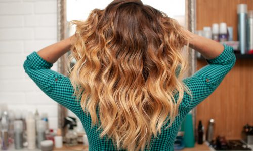 Beautiful ombre hair coloring on a girl with long hair, view from the back